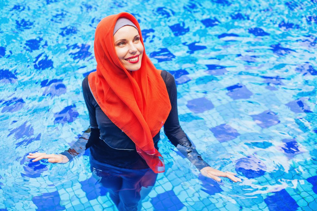 Image of a woman swimming in a burkini.