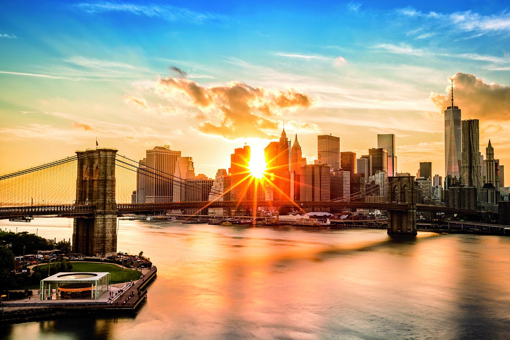 Brooklyn Bridge and the Lower Manhattan skyline at sunset, as viewed from Manhattan Bridge