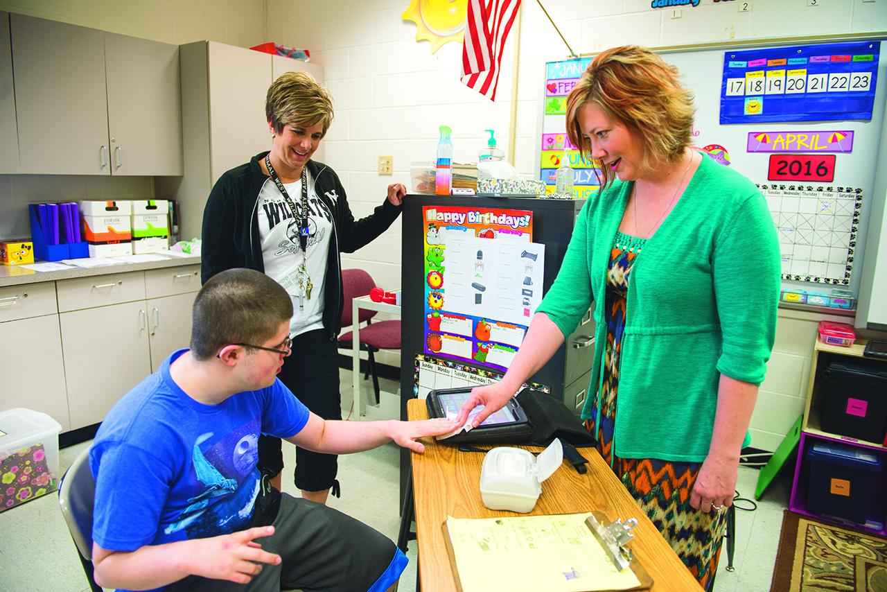 Kristi Probst with a student and a teacher