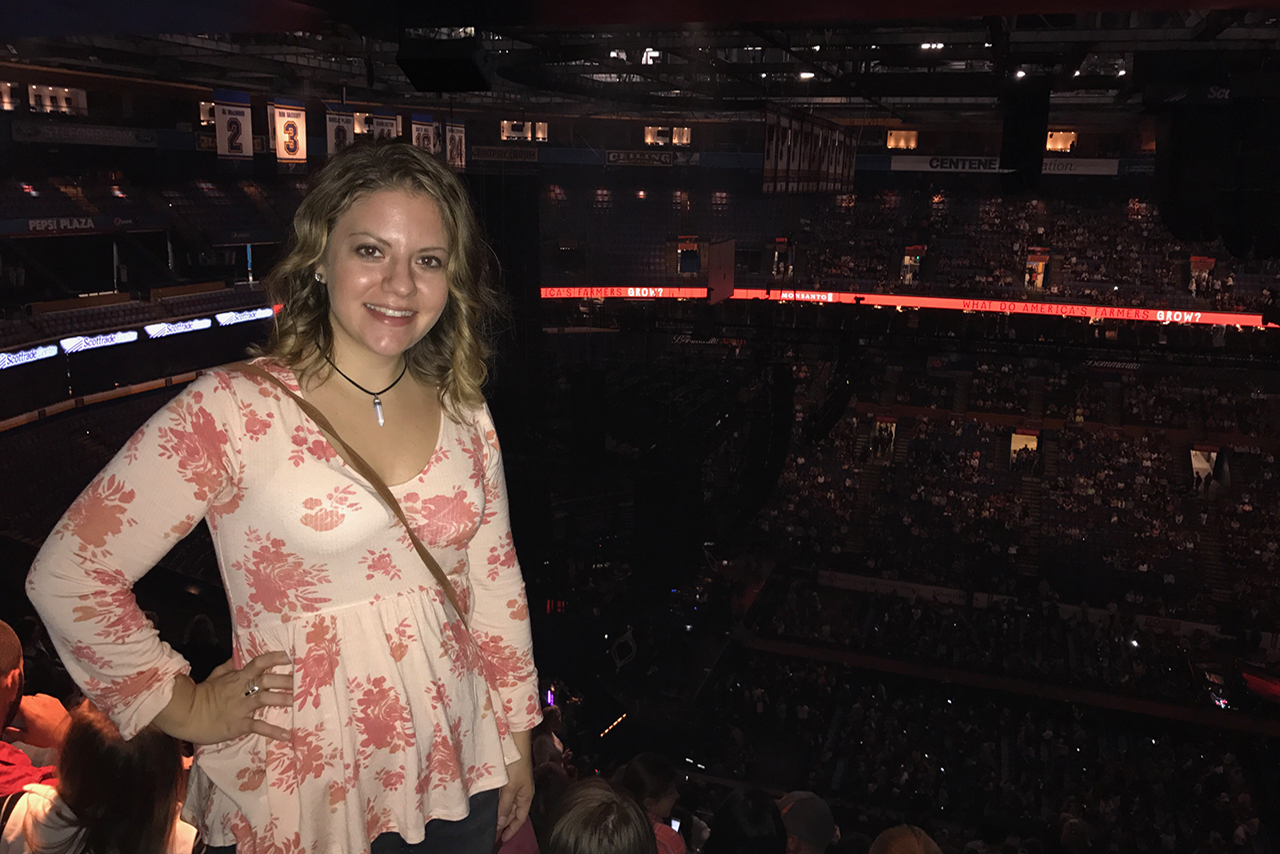 Jenna Cusumano poses at a concert