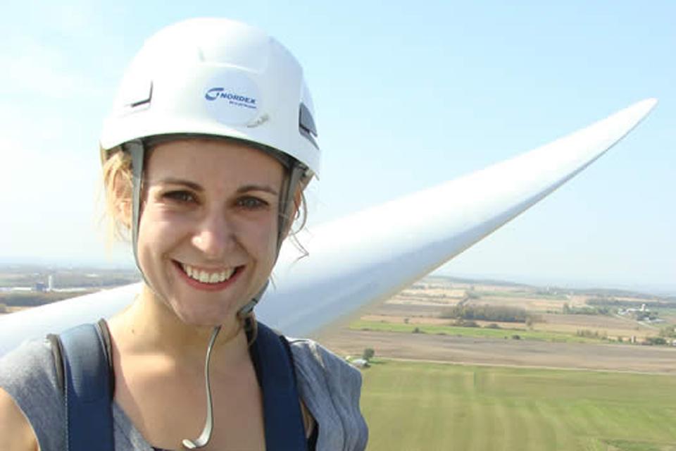 Christine Meier taking a selfie on top of a windmill.