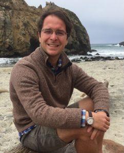 Drew Abney smiles on the beach