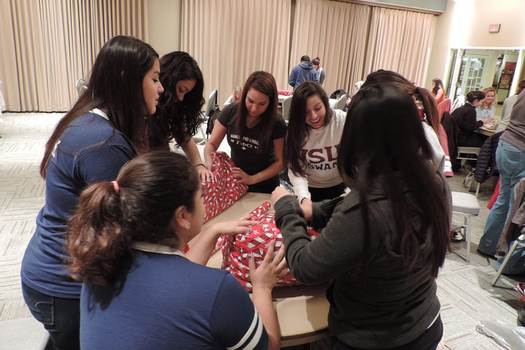 Students wrap gifts for Holiday Helper