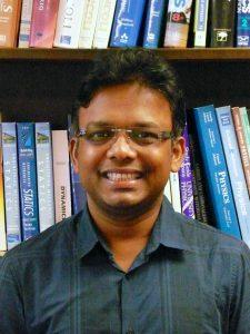 headshot of Uttam Manna