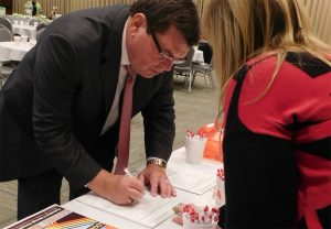 image of President Larry Dietz signing a SECA pledge form.