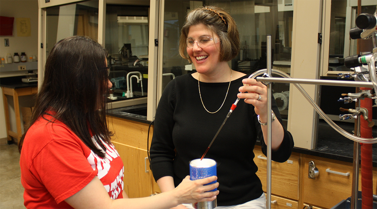 Image of A student working with Professor of Chemistry Lisa Szczepura.