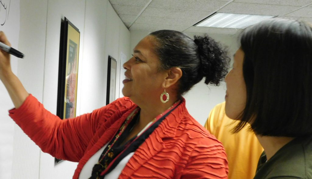 image of Climate Task Force Co-Chair Doris Houston works with another member of the group.