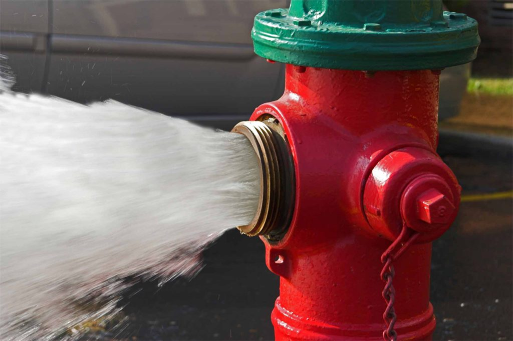 image of a fire hydrant gushing water