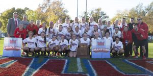 Redbird women's soccer team posing with Larry and Marlene Dietz and Larry Lyons