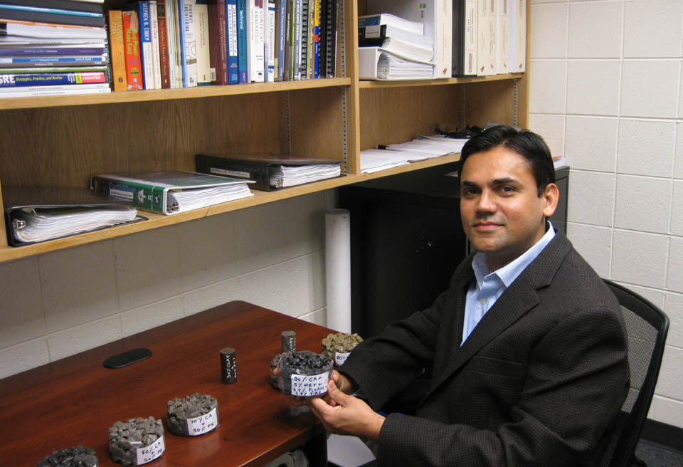 Pransho Solanki with plastic concrete samples.