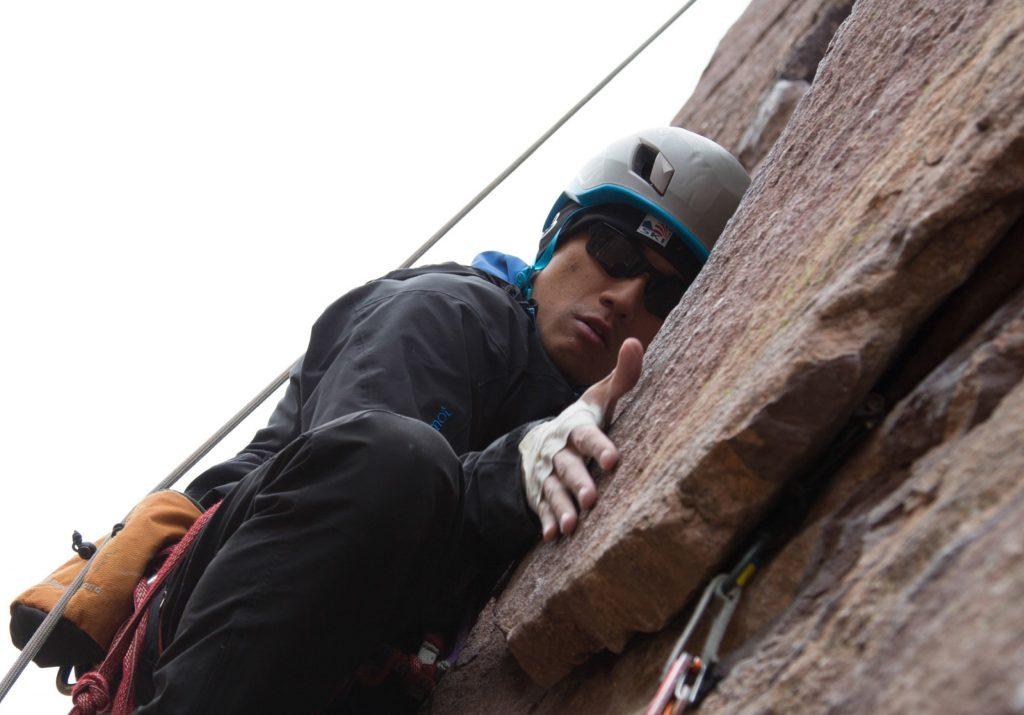 Photo of Steve Baskis rock climbing.
