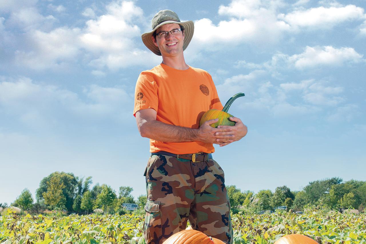 Mac Condill holding a pumpkin