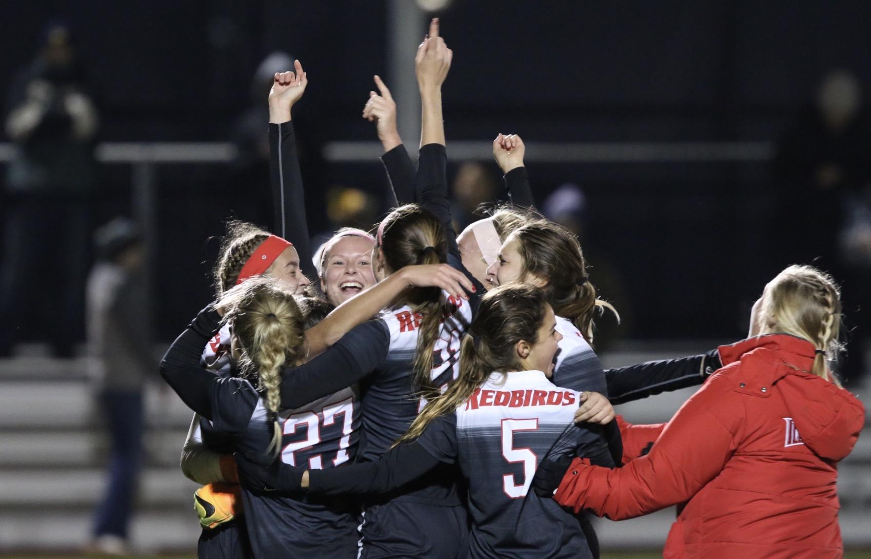 Women soccer players celebrating
