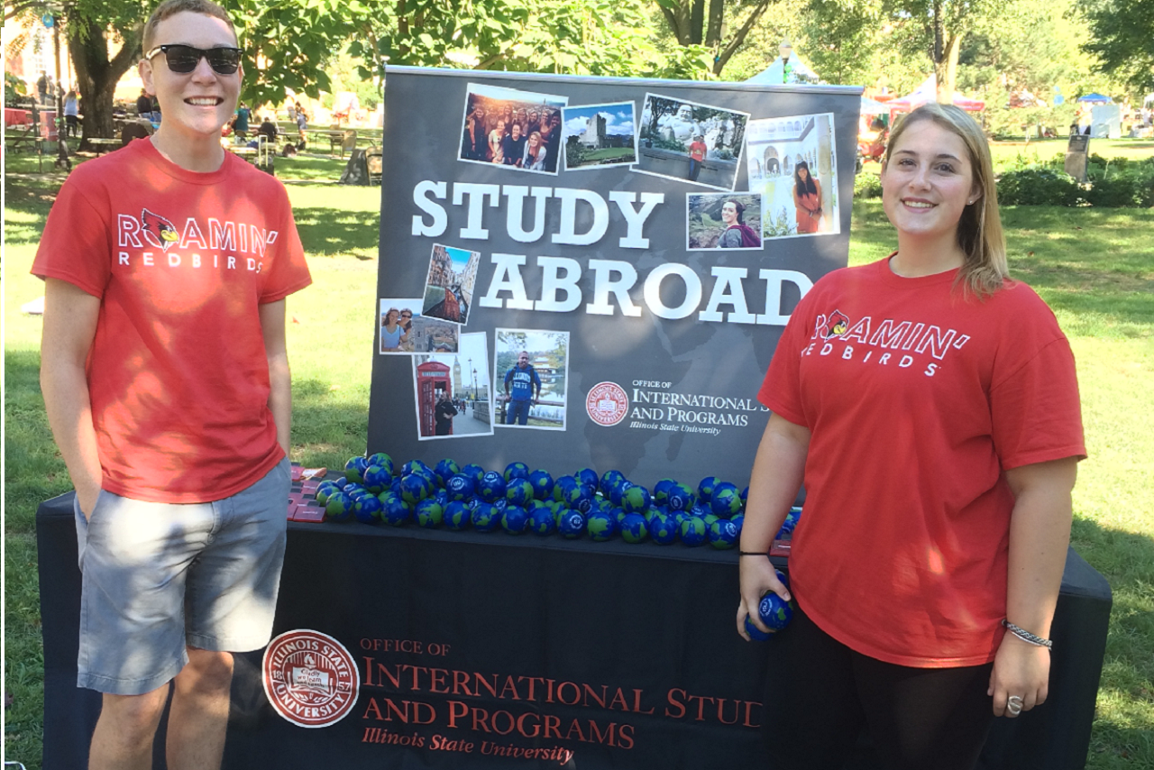 Study Abroad Ambassadors work a table on the Quad