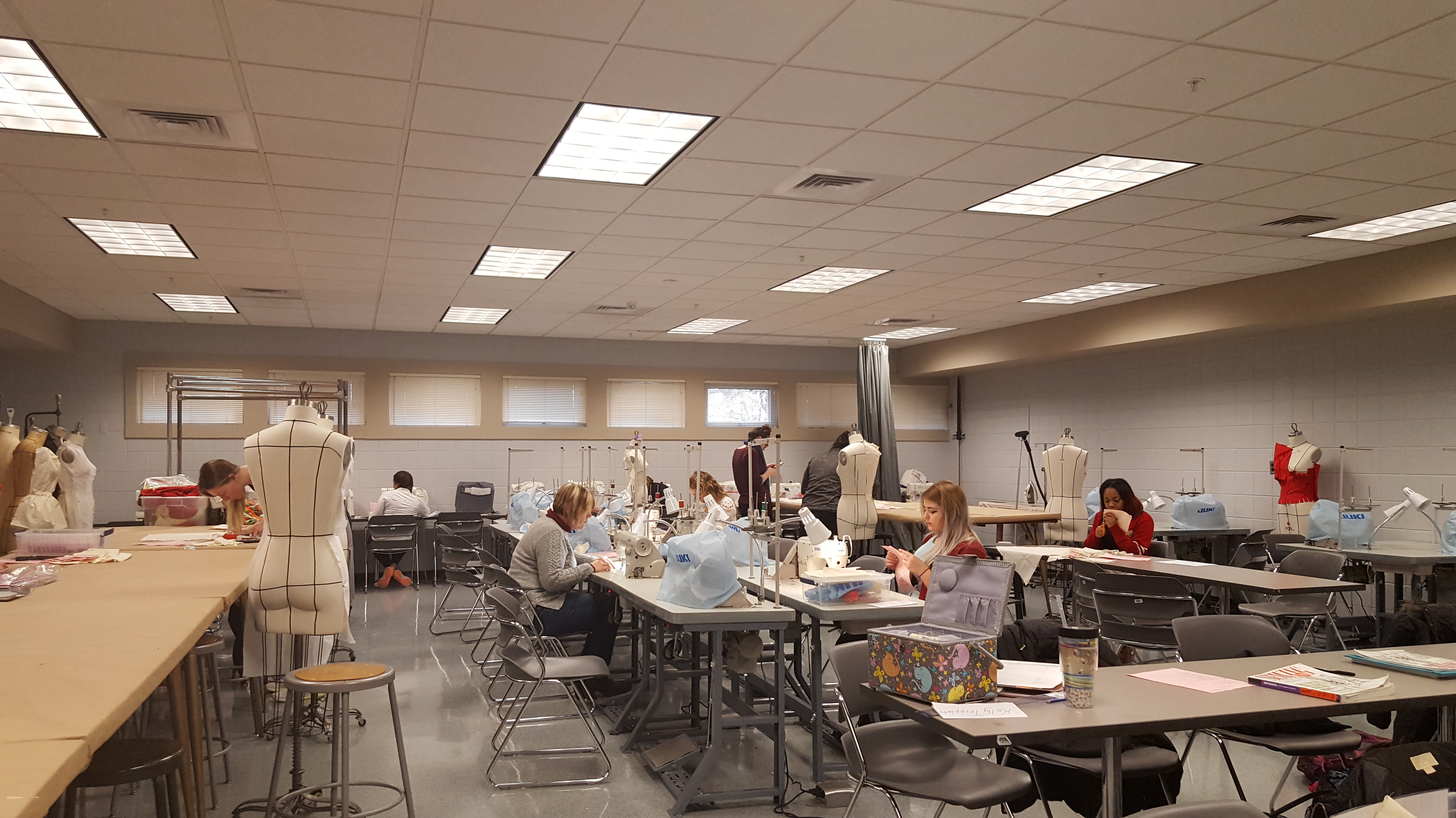 image of Students working in the Fashion and Merchandising Program .