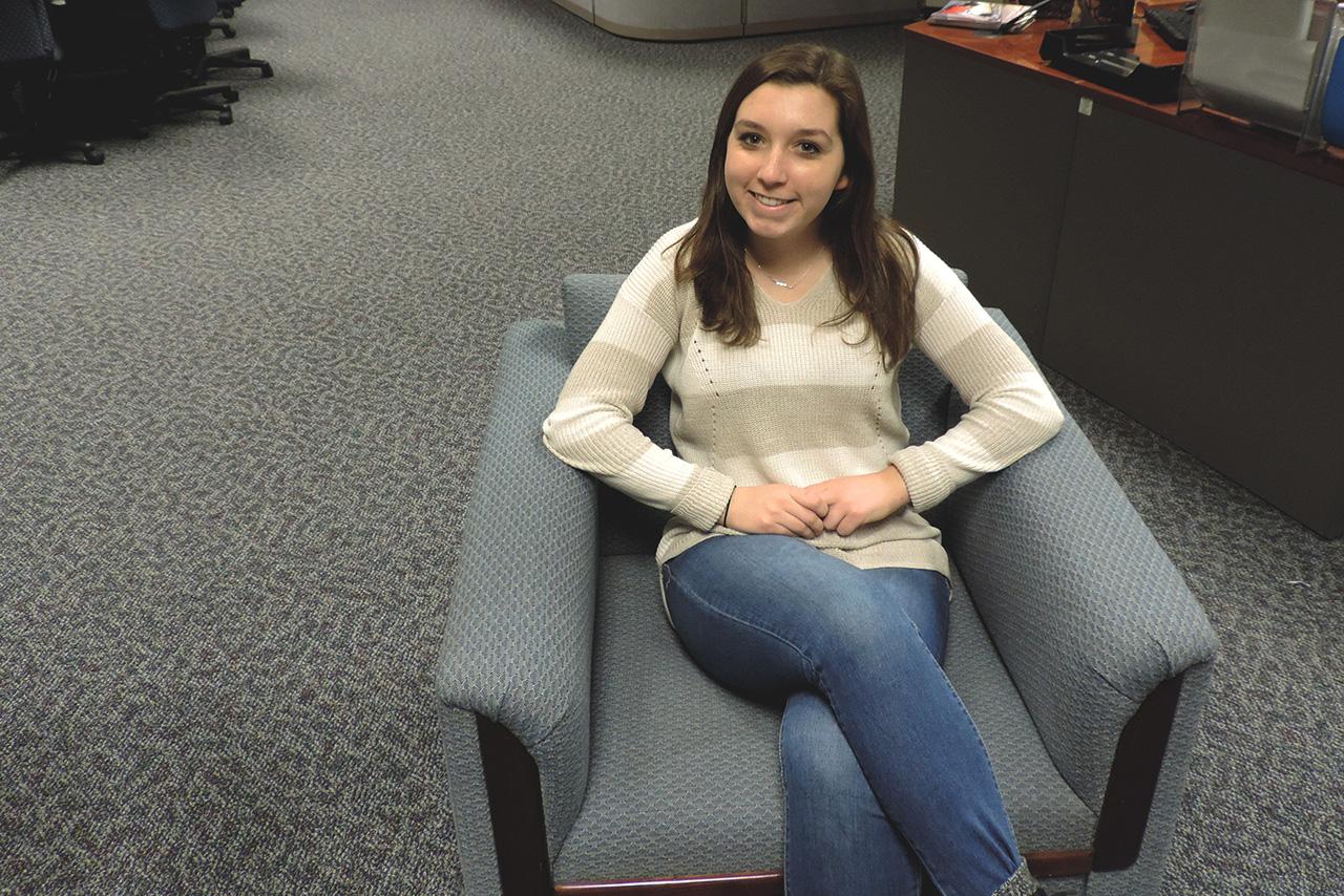 Elena Pivek sits in a chair