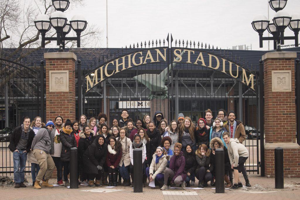 ISU students pose outside Michigan football stadium