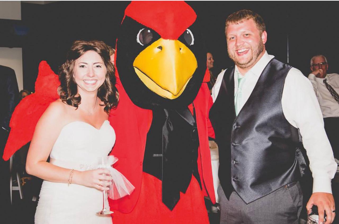 Elise Boni and Ryan Forner with Reggie Redbird