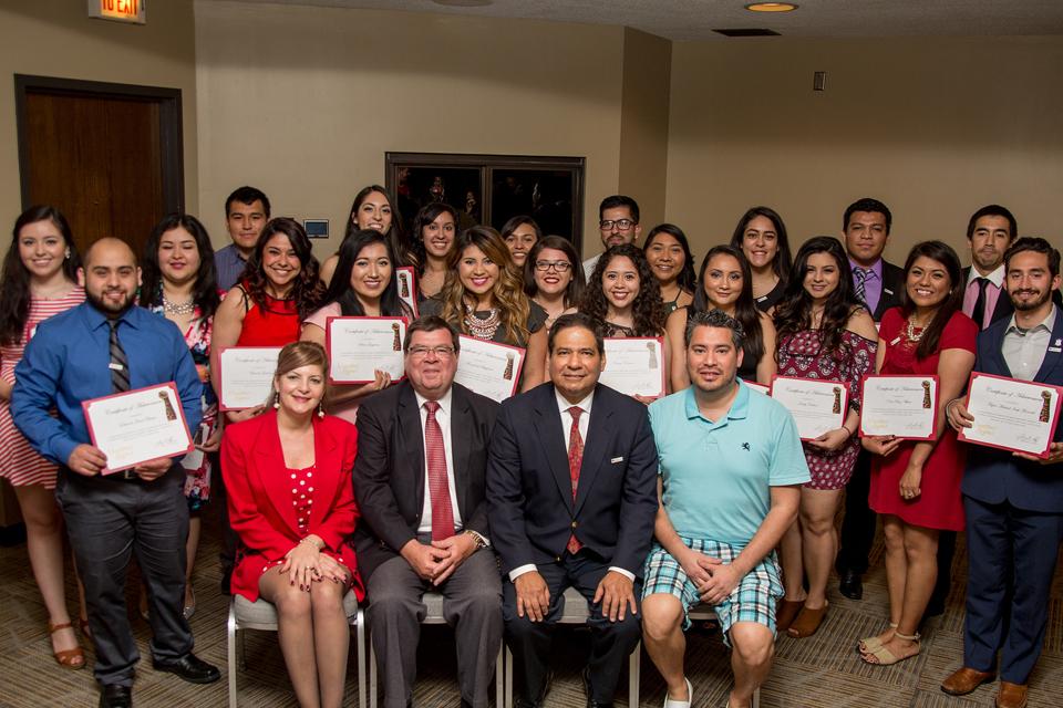 Latino students at graduation ceremony