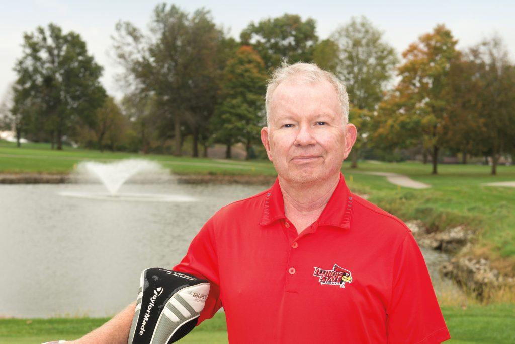 Professor Emeritus Robert Bradley on golf course with clubs