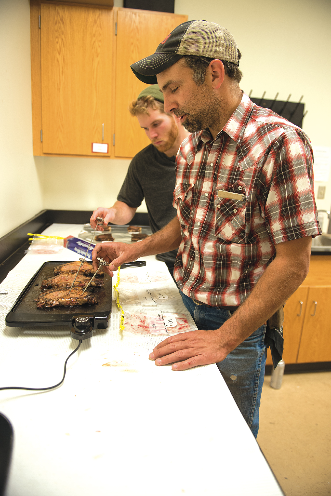 Rickard and Parmenter cook the steaks in order to see how well they retained their juiciness. The researchers then cut cores from the steaks and placed them into a Warner-Bratzler shear force device to test the meat's tenderness.