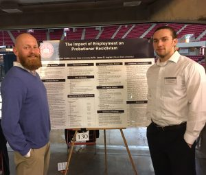 Criminal Justice Sciences Professor Jason Ingram and master's student Clayton Cottle at the University Research Symposium