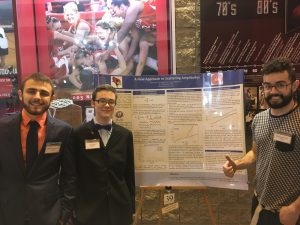 Santiago Pinto (right) with fellow researchers Joshua Henderson (left) and Cory Russ at the University Research Symposium