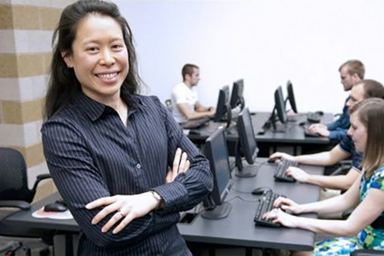 Accounting Professor Rosie Hauck in a classroom with students in front of computers
