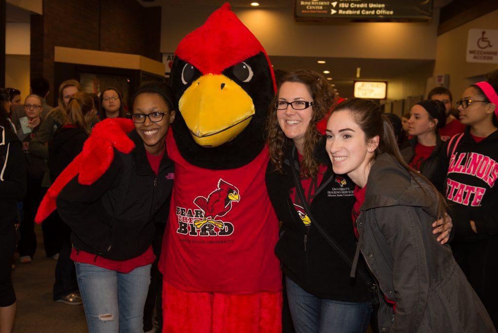Reggie Redbird with students