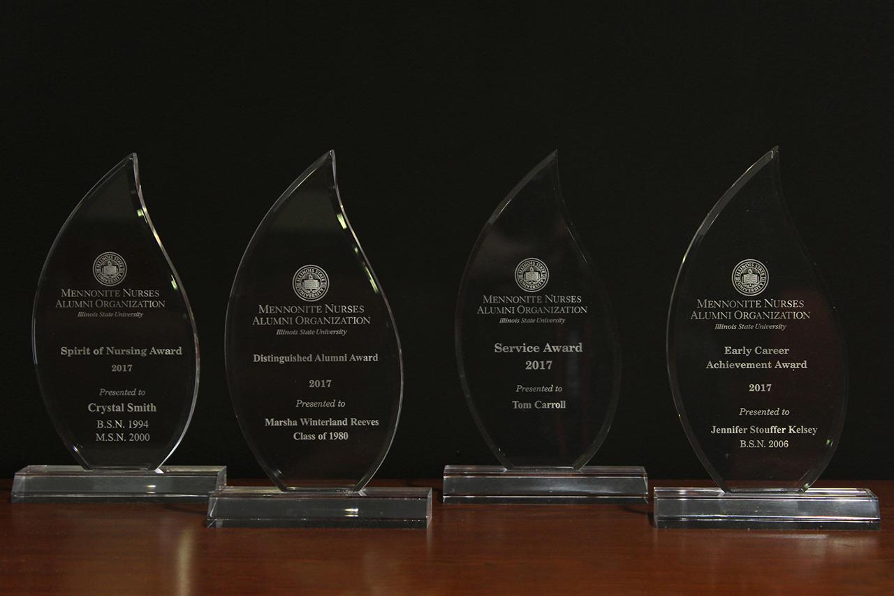 Four awards on a table
