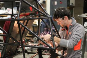 Cole Berglind working on solar car