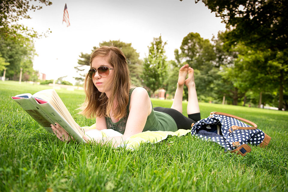 An Illinois State University student takes advantage of the summer weather on the Quad.