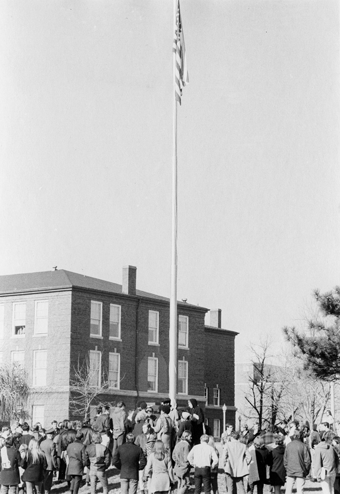 Members of the Black Student Association gather around the flagpole on December 4, 1969