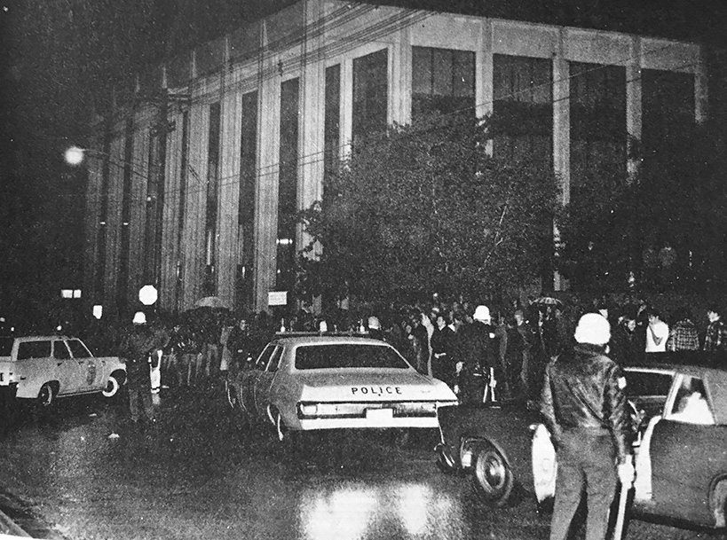 Police cars converge outside Hovey Hall on North Street, May 14, 1970