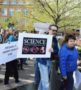 Illinois State Professor Steven Juliano holds a sign at the March for Science in Normal (Photo by Wolfgang Stein)