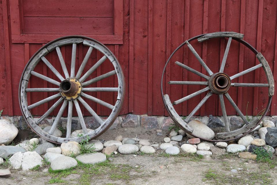 wagon wheels against wall