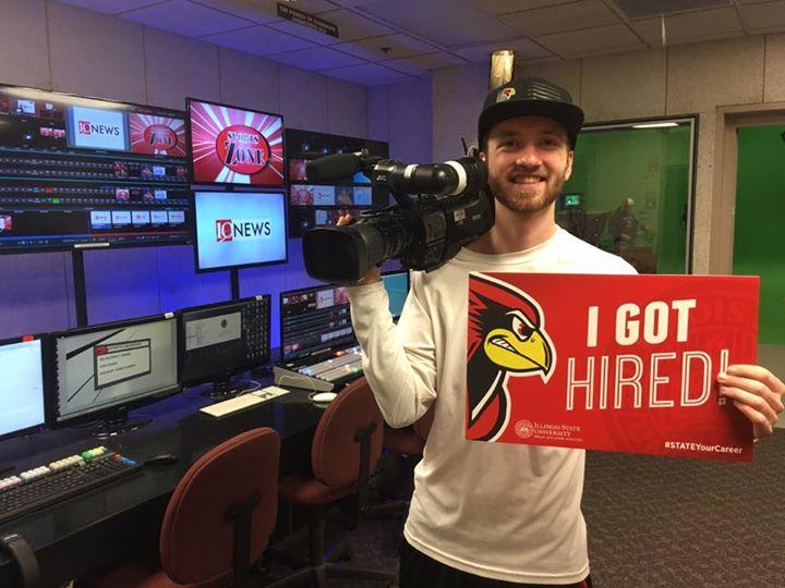 Kyle Vincent holds camera