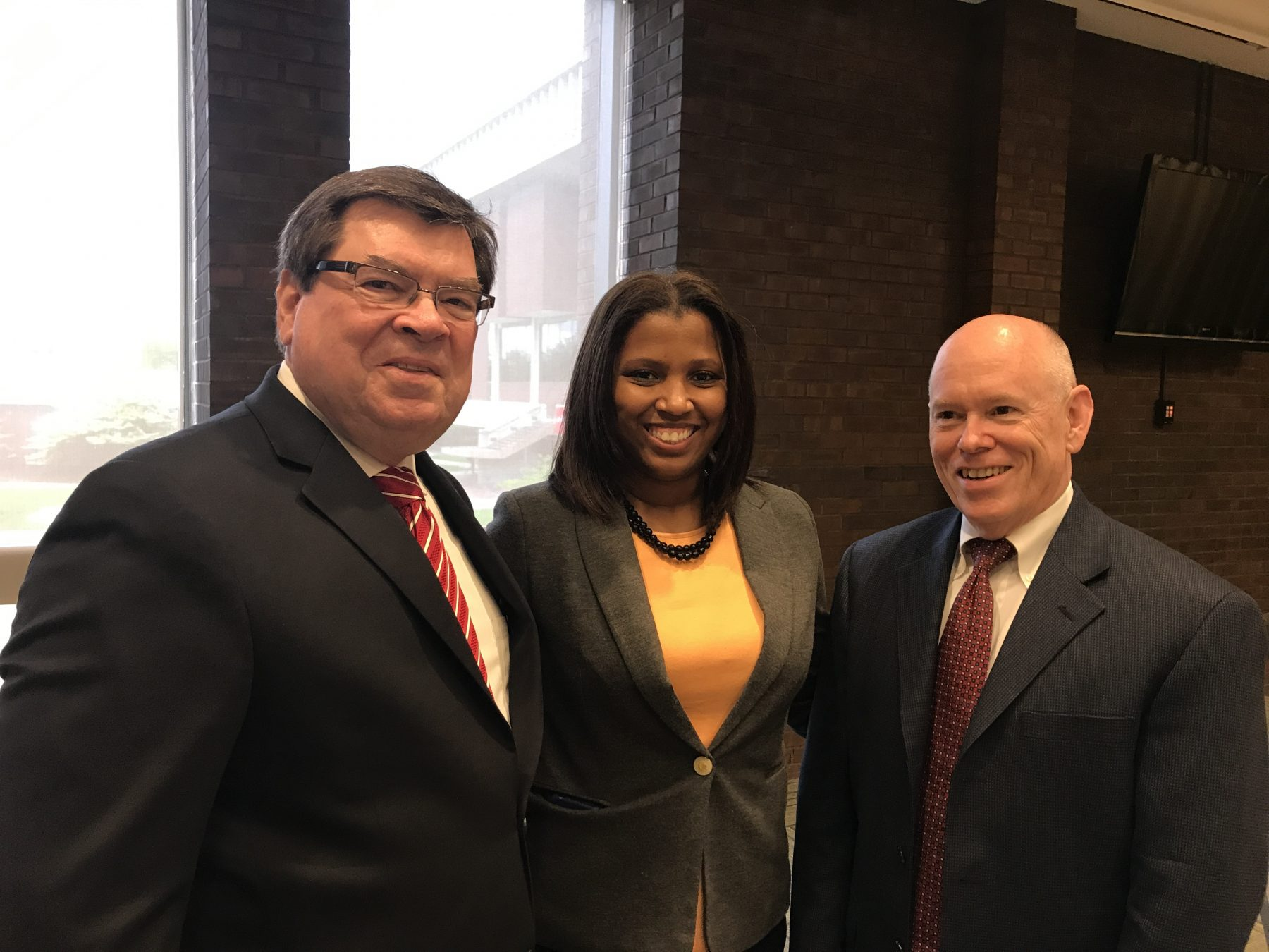 Professors Tiffany Puckett and Thomas McClure (right) with President Larry Dietz