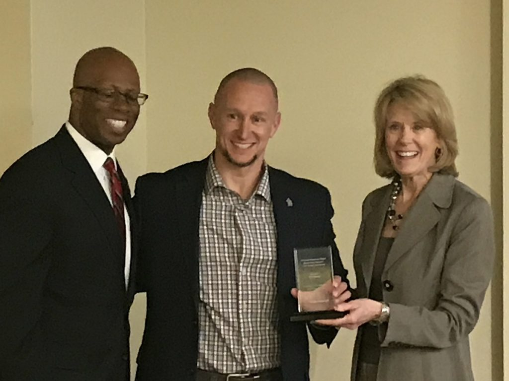 Erik Rankin (center) with Vice President for Student Affairs Levester Johnson and Interim Vice President for Academic Affairs and Provost Jan Murphy