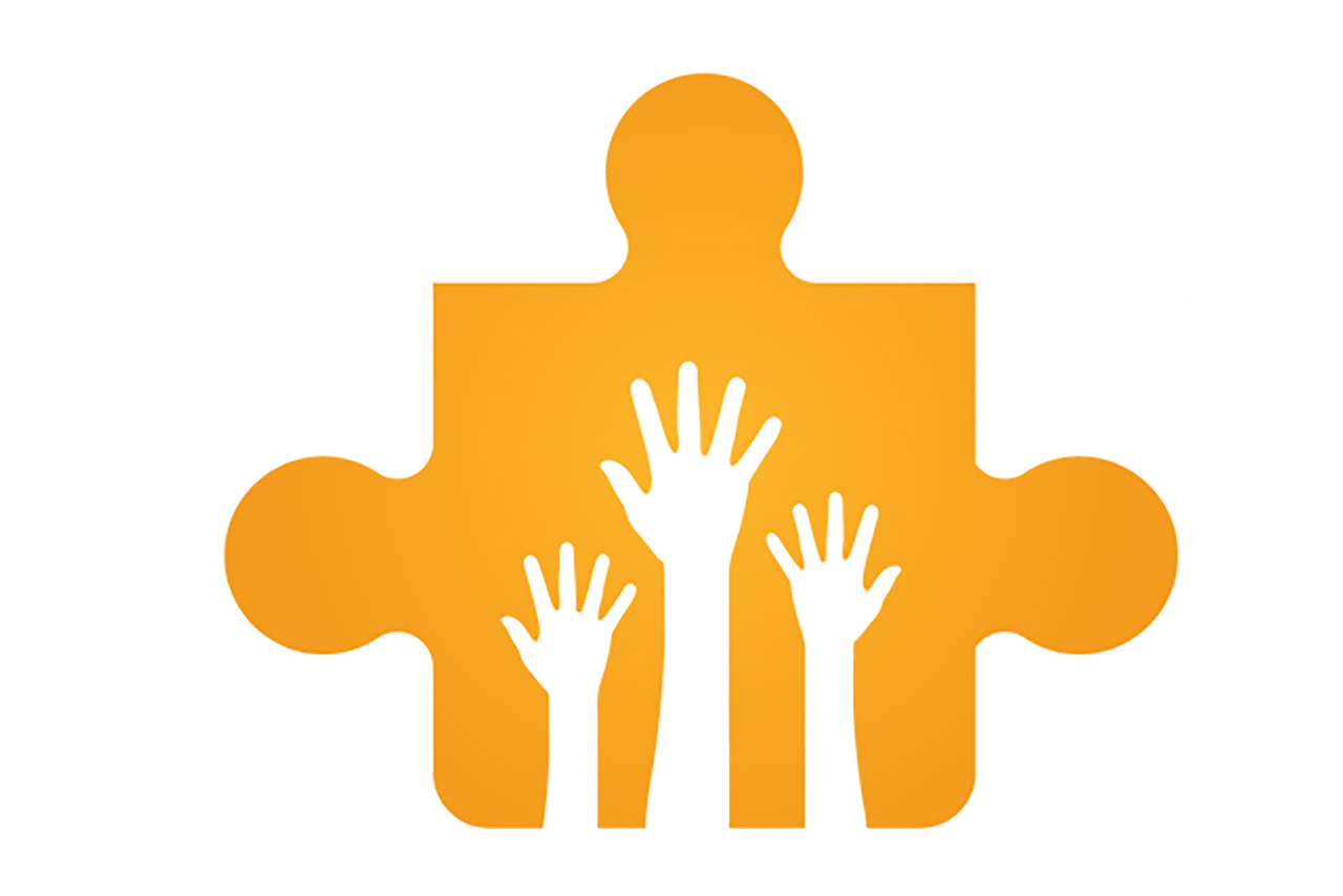 Puzzle piece with hands raised