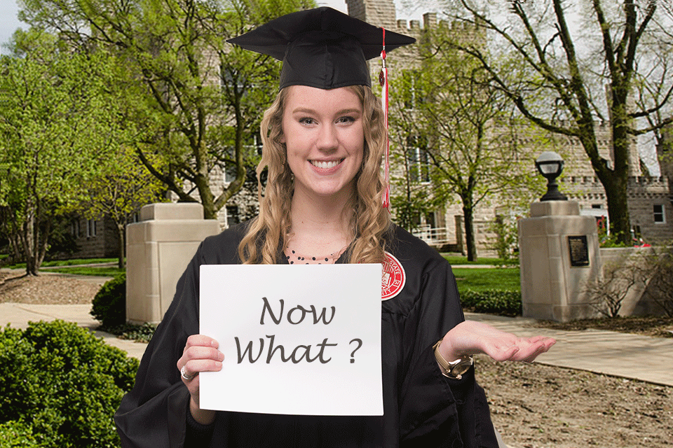 """New graduate holding a """"Now what?"""" sign"""