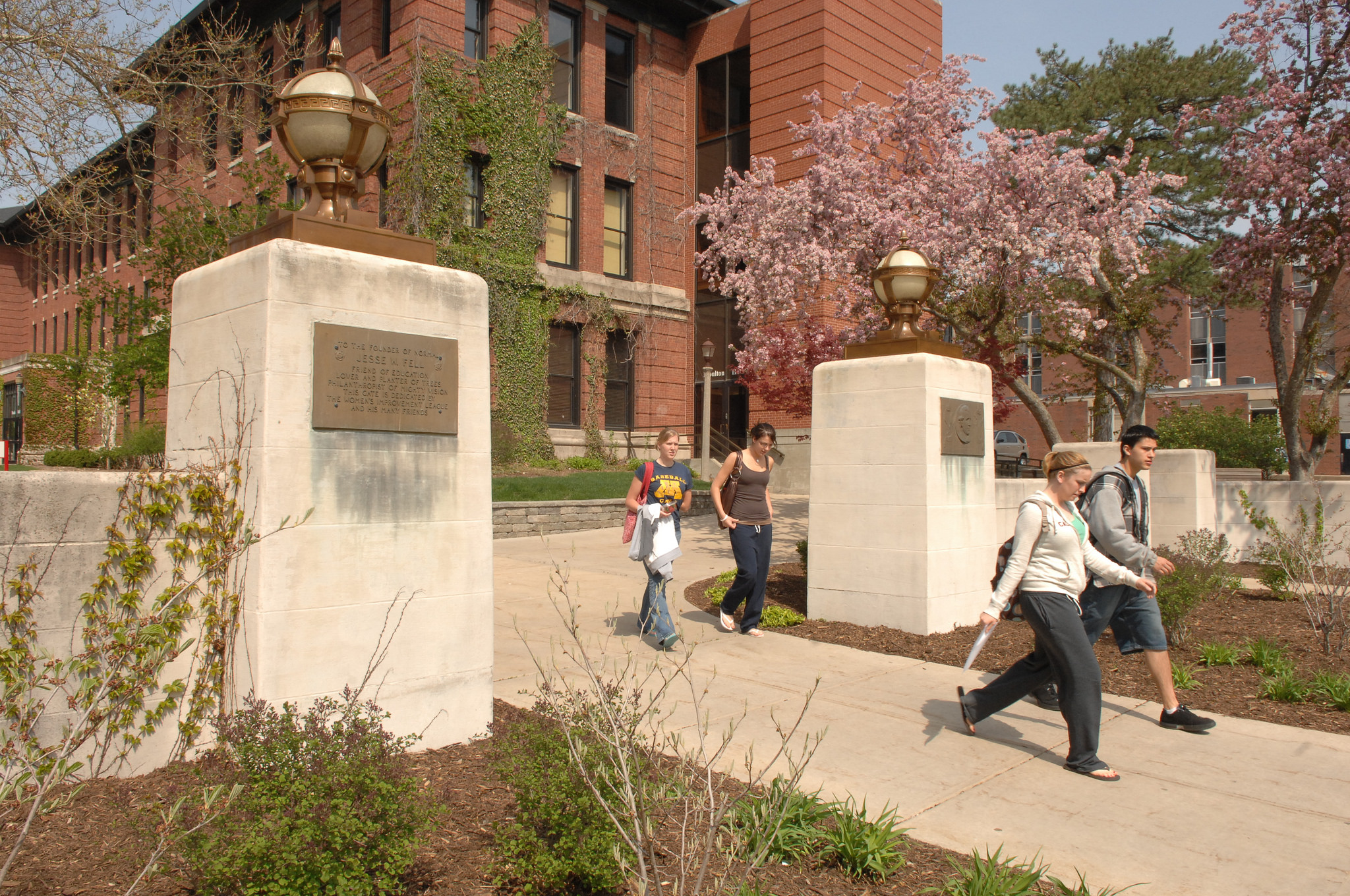 Students stroll onto the Quad past the Fell gates in the spring.