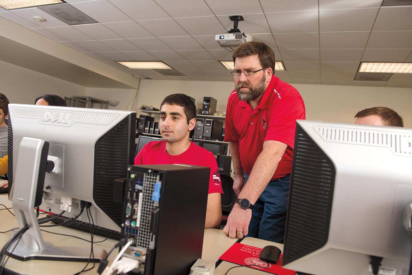 Associate Professor Glen Sagers works with student Andrew Pelletier.