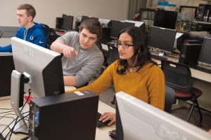 Students Evan Rappe, Nicholas Dangles and Karthika Venkatraman, from left, are learning about cybersecurity—one of the most in-demand jobs in the computing industry.