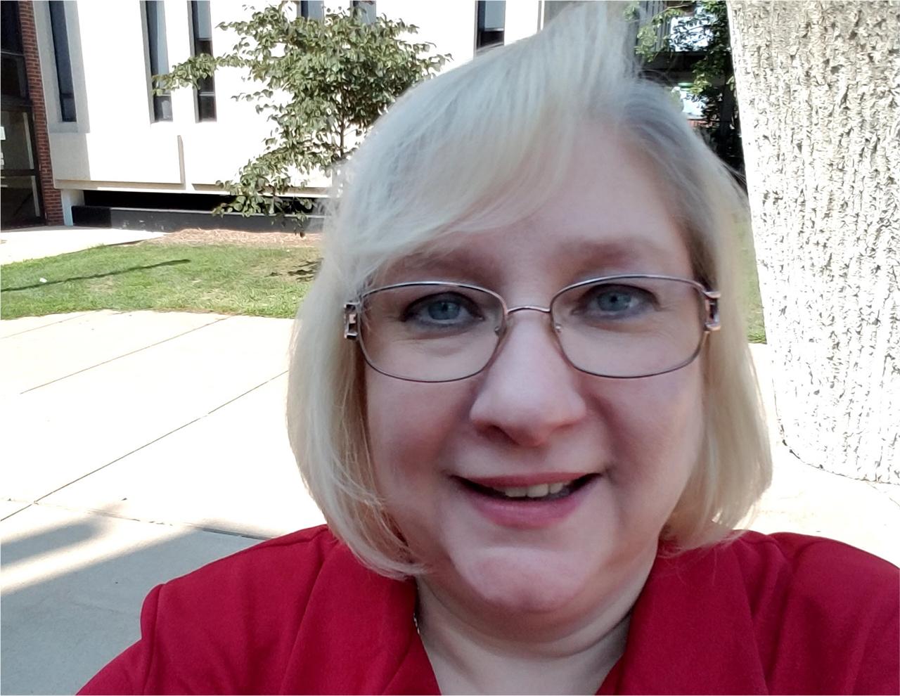 Pam Burress standing outside