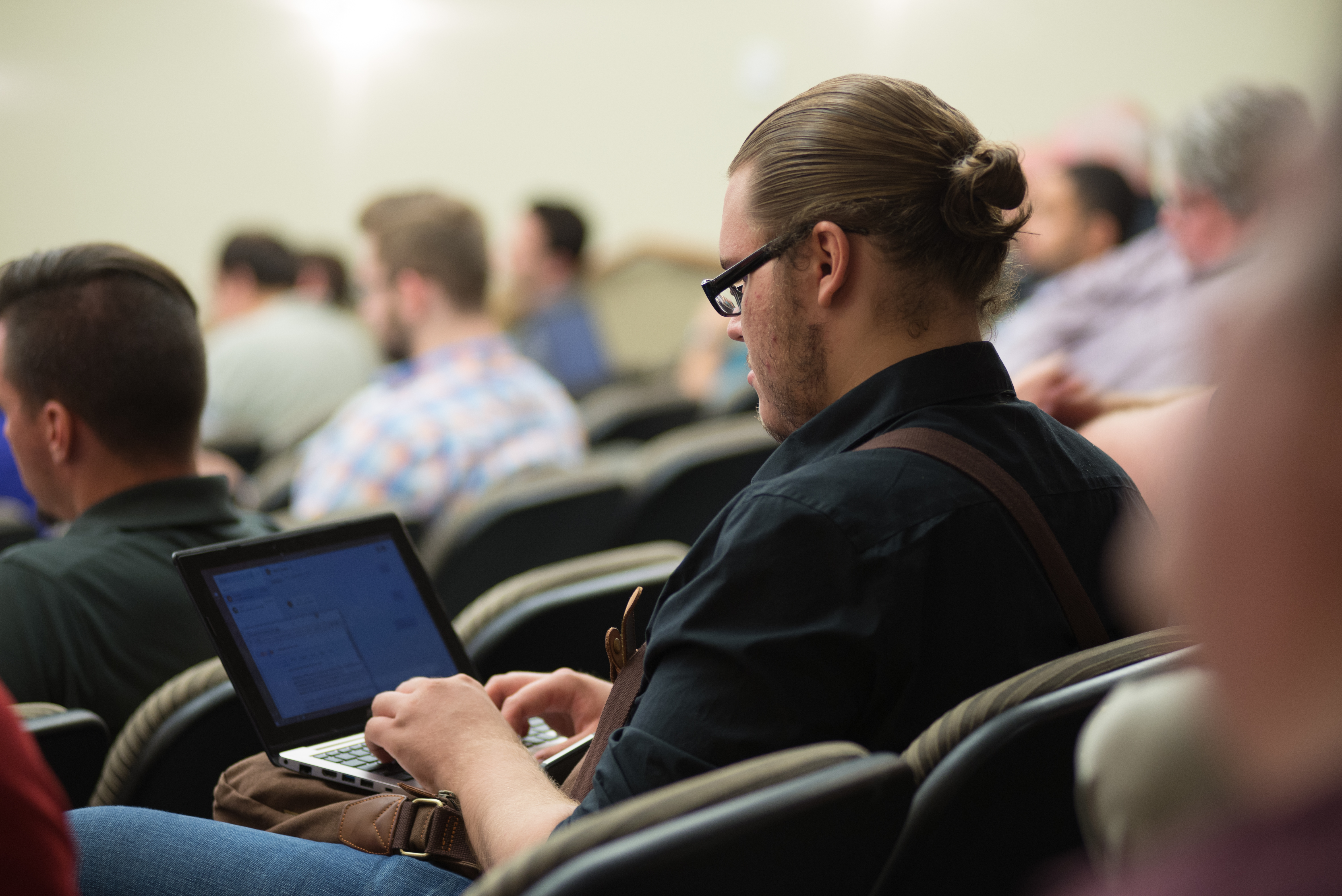 CIT 2017 attendee takes notes on laptop