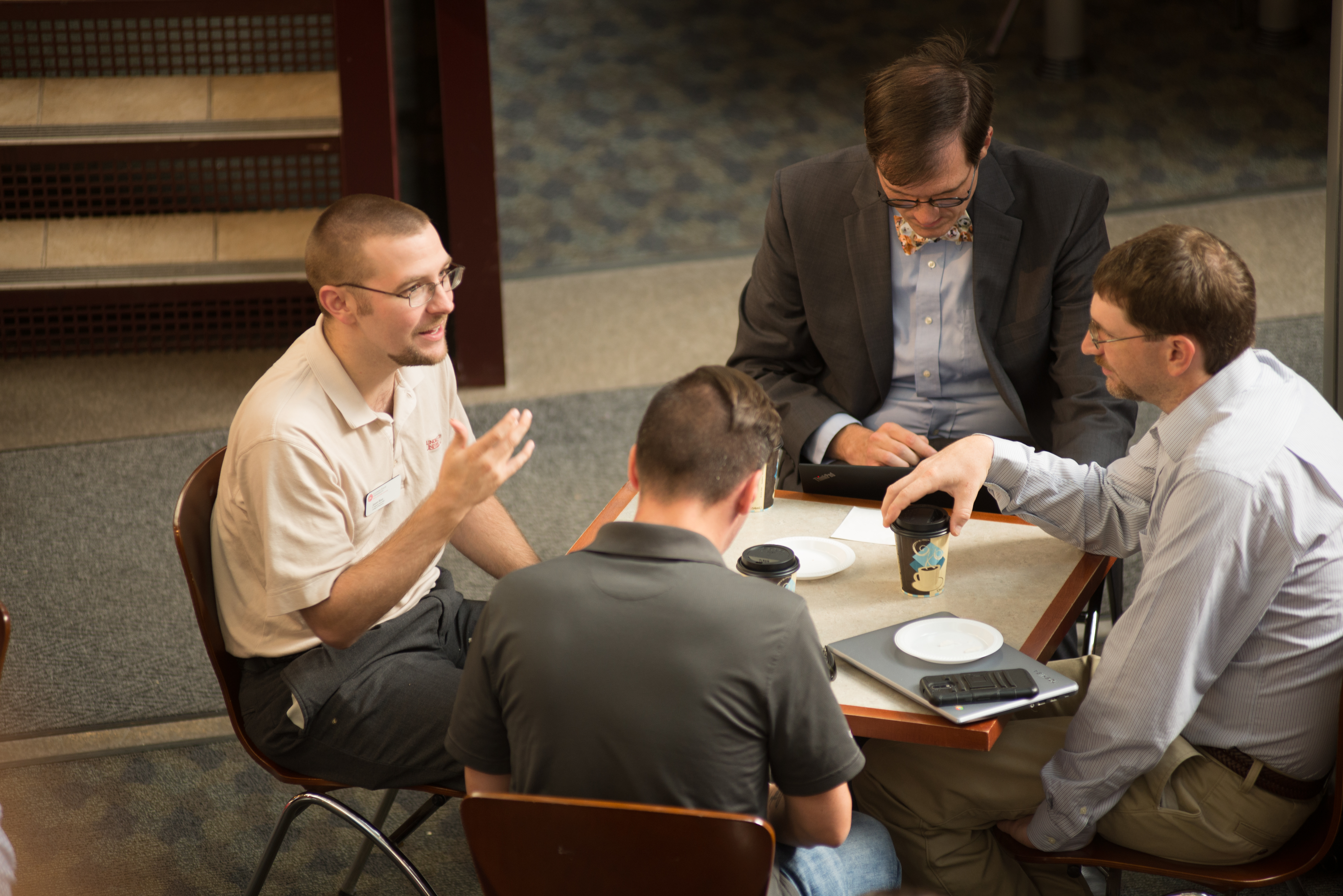 Four IT staff converse at CIT 2017