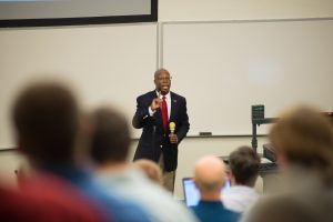 Vice President of Student Affairs, Levester Johnson, addressing a large crowd at CIT conference.