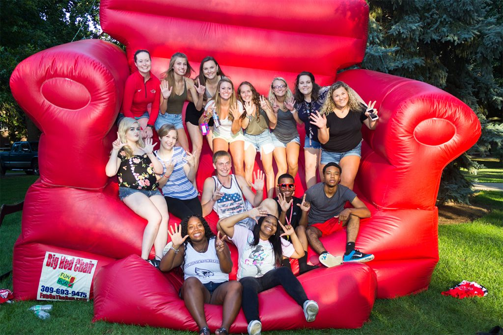Students in big red chair at Welcome Week 2017.