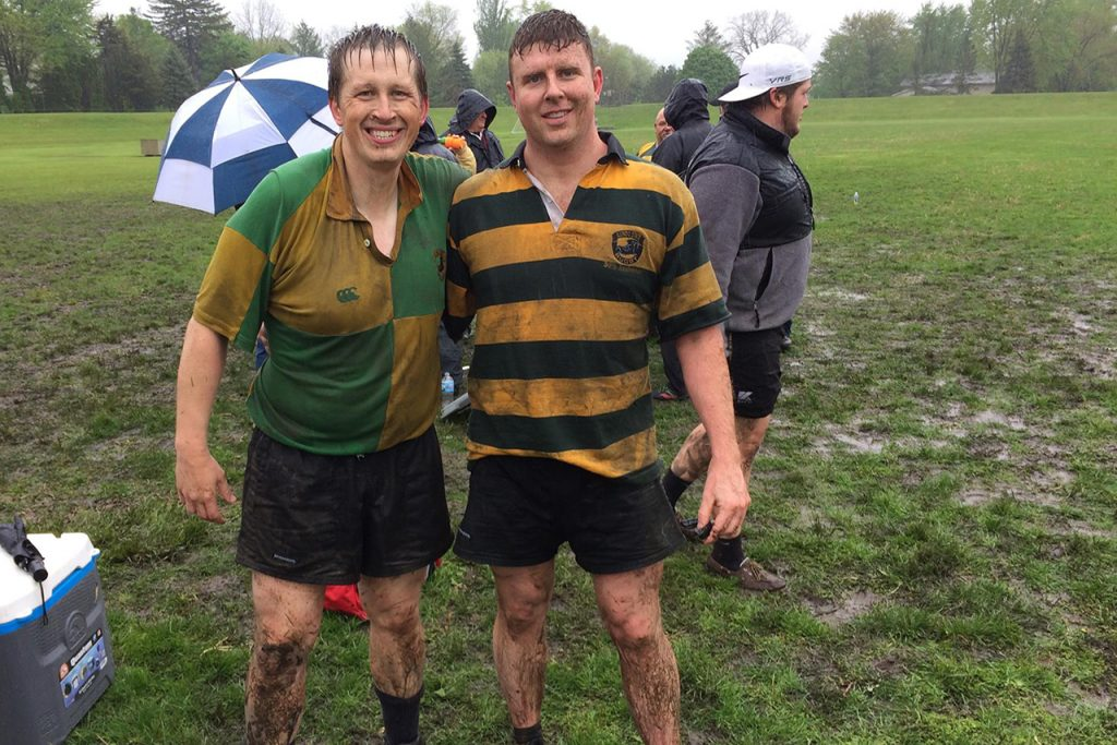 Club rugby alumni celebrate after a muddy match against current students at the 45th anniversary reunion in 2016.